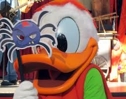 Donald Duck poses with his spider mask.